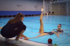 Judit Requena (left) helps with ballet leg positioning. Photo Christina Marmet/Inside Synchro