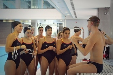 The team listens to Xavi Guillen as he explains cardio swimming exercises before practice. Photo Christina Marmet/Inside Synchro