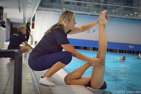 Anna Vega helps Xavi Guillen with his bent knee position. Photo Christina Marmet/Inside Synchro